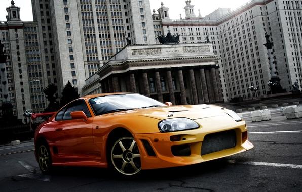 Картинка оранжевый, фон, тюнинг, здание, спорткар, Toyota, МГУ, tuning, Supra, Тойота, Супра, предок