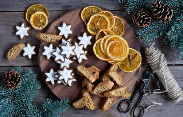 Картинка ветки, ель, апельсины, Новый Год, печенье, Рождество, звездочки, шишки, праздники, глазурь, новогоднее