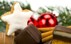 Картинка шоколад, ветка, печенье, конфеты, ёлка, корица, звёздочка, ёлочные украшения, глазурь