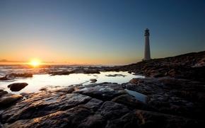 Обои солнце, камни, берег, маяк