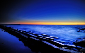 Обои закат, море, сумерки, небо, камни, блоки