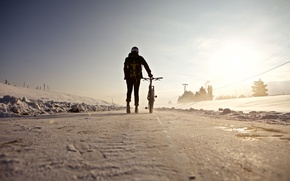 Обои велосипед, снег, зима, дорога, гонщик, человек, линия электропередач, тень, солнце