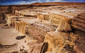 Обои шоколадный водопад, потоки грязи, каньон, небо, скалы, река, облака