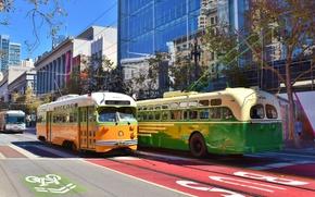 Обои движение, город, автобус, дома, трамвай, улица