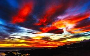 Картинка море, небо, облака, горы, тучи, камни, скалы, краски, берег, зарево
