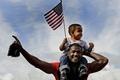 Картинка флаг, чернокожие, ребёнок, бегун, спортсмен, Джастин Гатлин, Justin Gatlin, афроамериканцы, негры, спринтер, мужчина, небо, мальчик