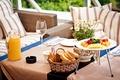 Картинка сок, черника, ягоды, малина, хлеб, сервировка, бокалы, завтрак, ананасы, тарелки, клубника, ваза, стол, абрикосы, апельсиновый, ...