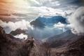 Картинка мужчина, горы, приключения, солнце, долина, облака