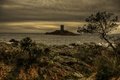 Картинка море, тучи, камни, скалы, побережье, Франция, остров, башня, вечер, горизонт, кусты, Le Dramont