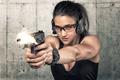 Картинка оружие, выстрел, пуля, фон, лицо, наушники, очки, пистолет